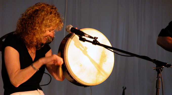 Cathie Ryan playing bodhrán